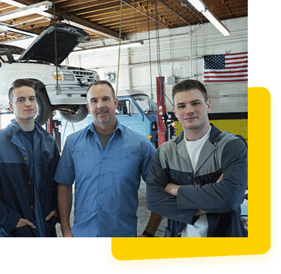 team of automotive mechanics in a garage